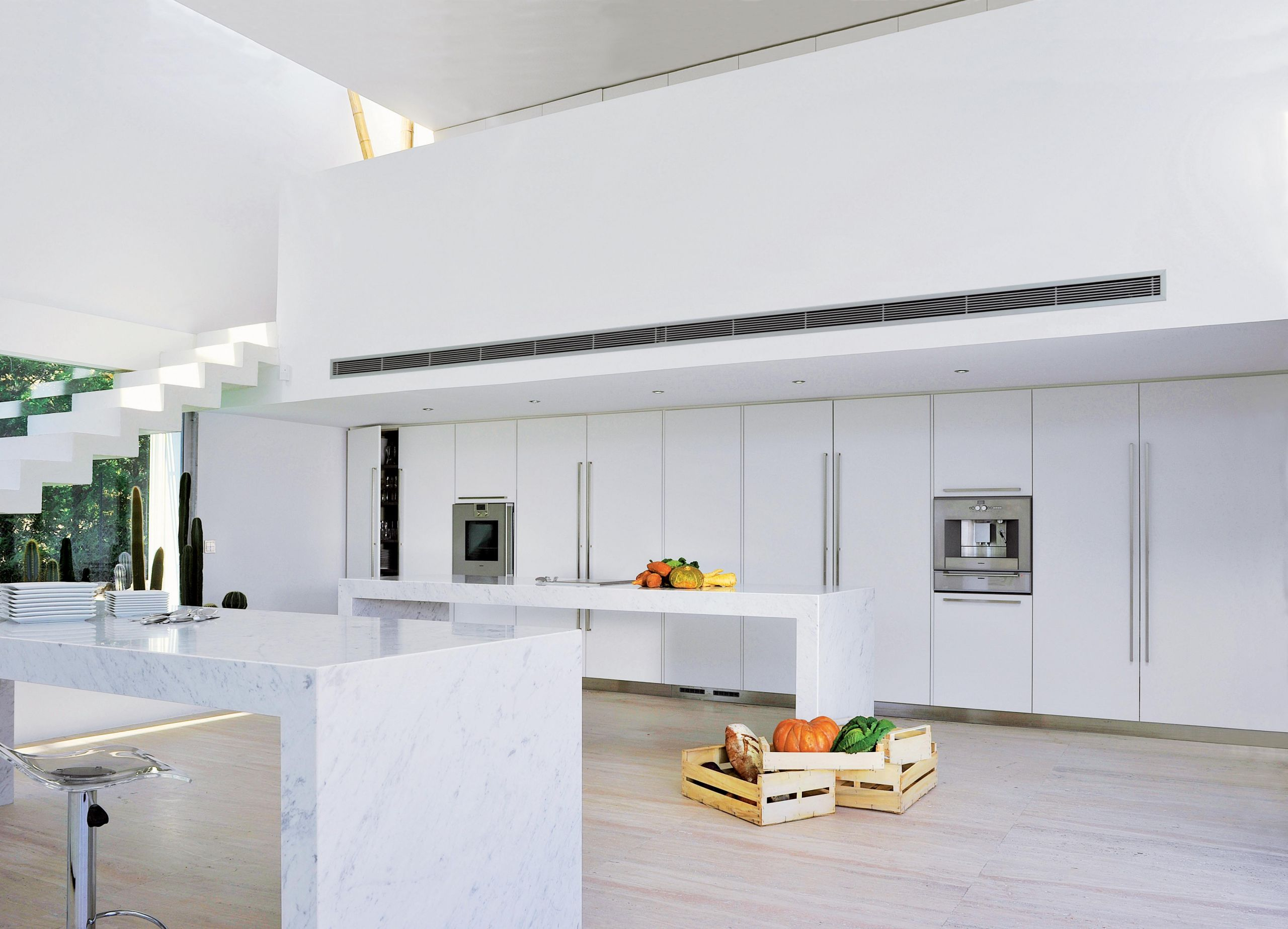 Immaculate white lacquer kitchen with Carrera marble countertops