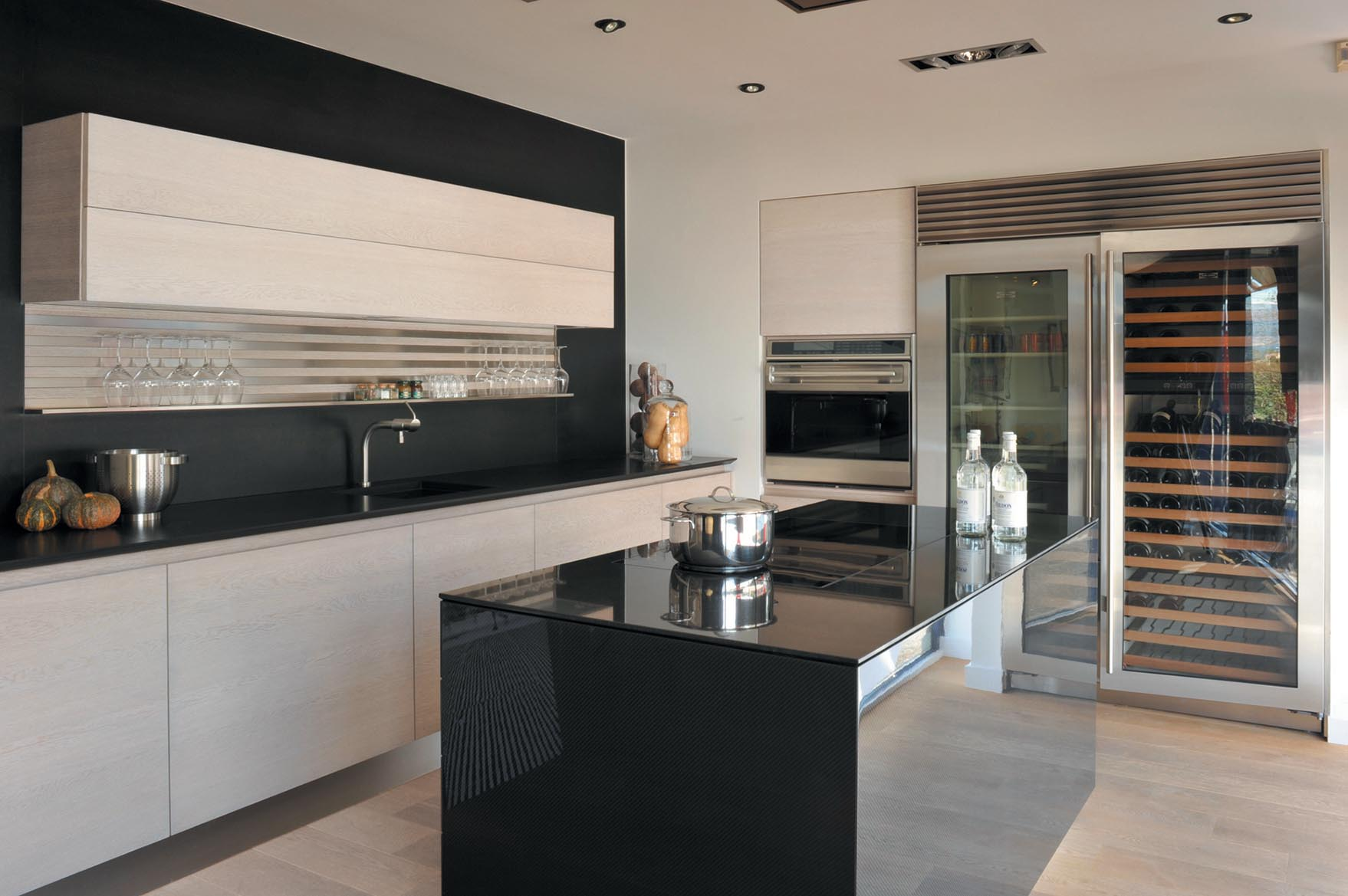Ultra-modern carbon fiber paired with unfinished oak in this stunning luxury kitchen