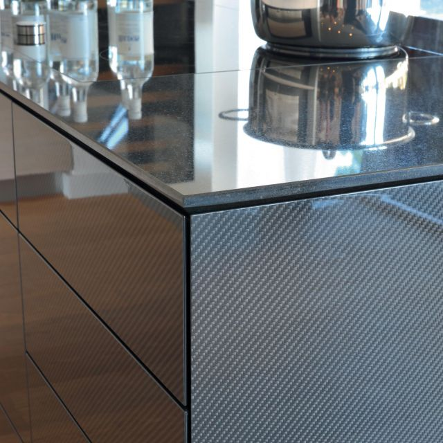 Ultra-modern carbon fiber paired with unfinished oak in this stunning luxury kitchen - 1