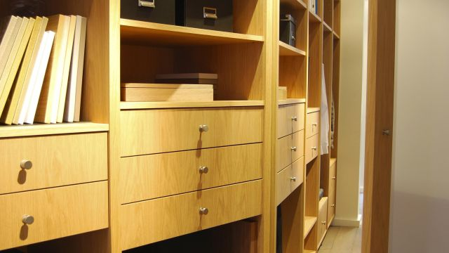 A custom closet pairing wood and leather
