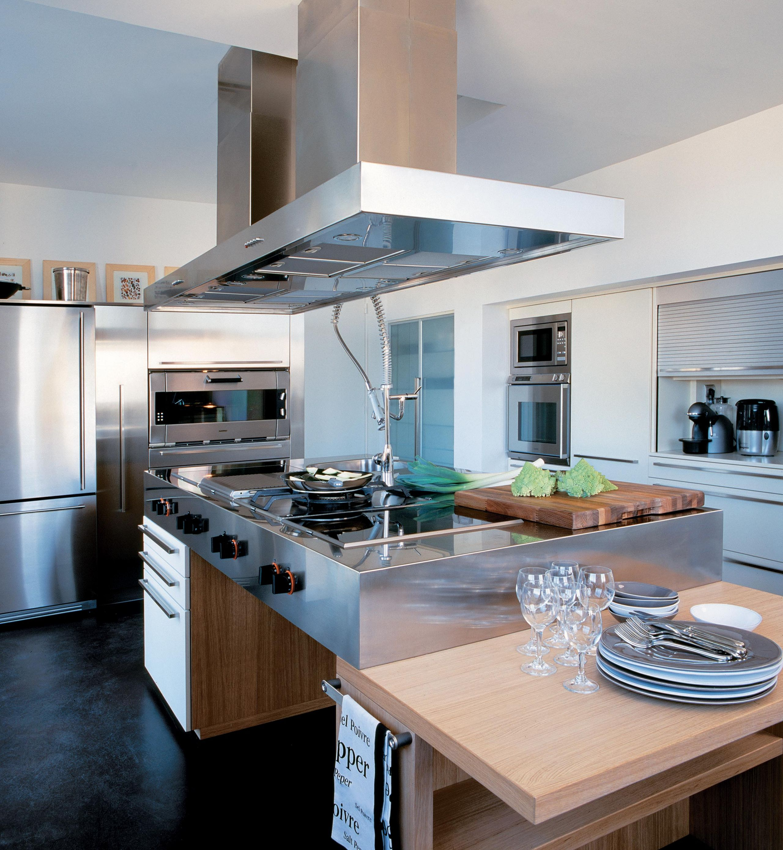 A majestic central island forming the heart of this unique kitchen
