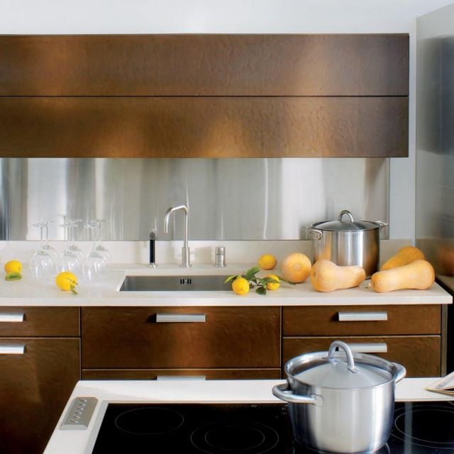A bold kitchen with cool metallic elements and robust textures - 1