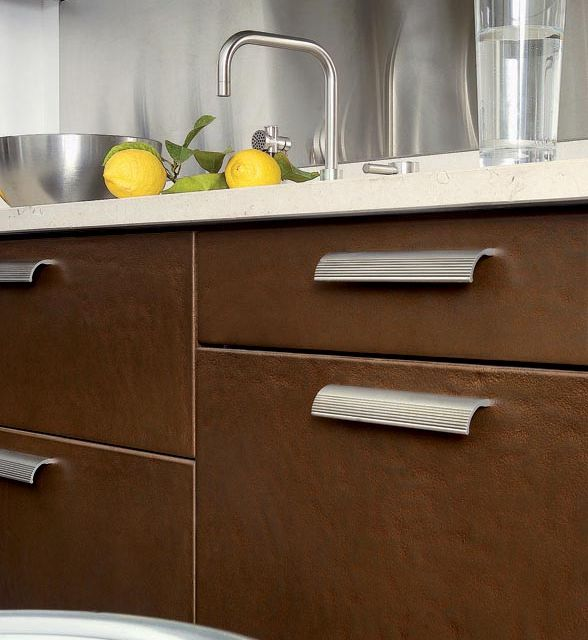 A bold kitchen with cool metallic elements and robust textures - 4