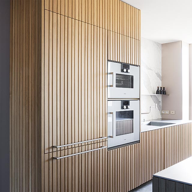A contemporary style kitchen dressed in the sophisticated warmth of wood. - 3