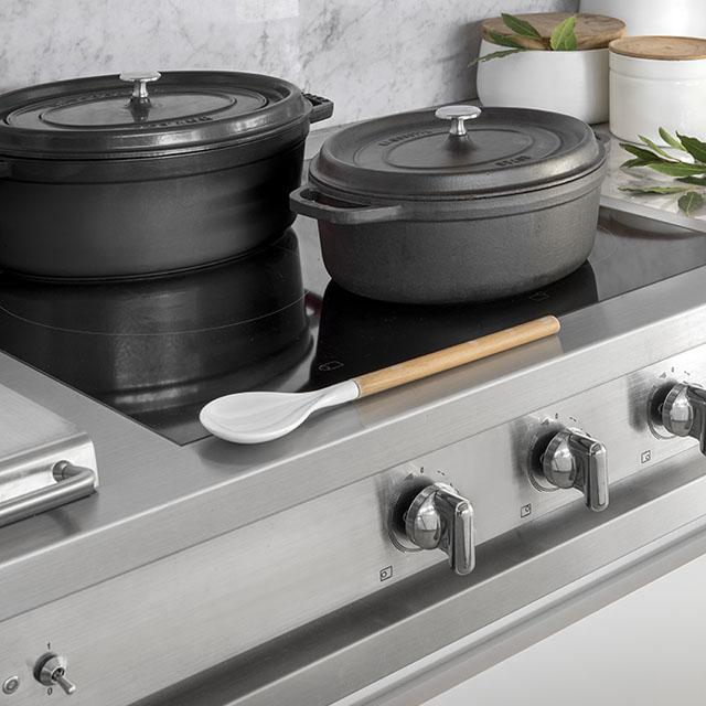 A well-balanced contemporary kitchen created through custom renovation. - 1